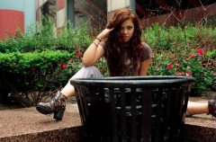 young woman girl model brunette wavy hair garbage can