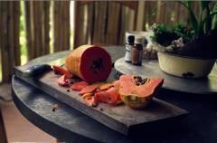 film photography food papaya fresh cut cutting board seeds