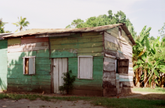 film photography old house shack green colorful painted pastel tropical