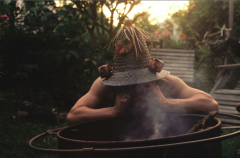 film photograph starting fire smoke wizard hippie outdoors crazy hat straw