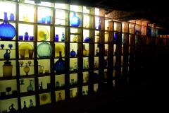 blue amber glass bottles shelves house on the rock