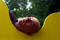 film photograph portrait playground man yellow rain water droplets