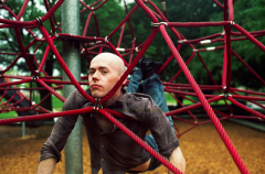 film photograph portrait playground man lying spiderweb rope equipment