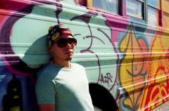 film photograph portrait graffiti bus young man sunglasses
