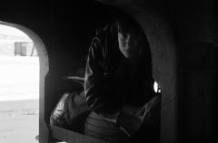 film photograph portrait young woman hiding dark shadow