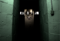 digital photograph dark light shadow contrast chiaroscuro basement asylum creepy brick lighting exit sign