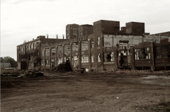 abandoned warehouse crumbling sepia black and white