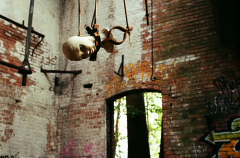 abandoned building urbex factory mannequin head hanging creepy
