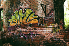 abandoned building graffiti wall colorful brick