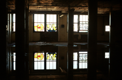 film photograph dark shadows chiaroscuro abandoned building water reflection puddle graffiti window