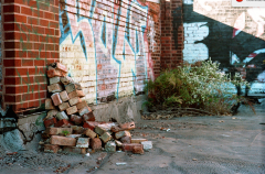 abandoned building film photograph roof brick pile graffiti