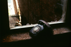 abandoned building film photography old rotary dial telephone