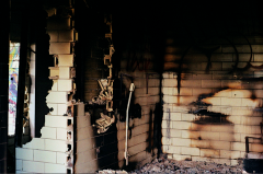 abandoned building film photograph burnt fire broken bricks
