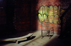 abandoned building film photograph church urbex graffiti chair brick wall