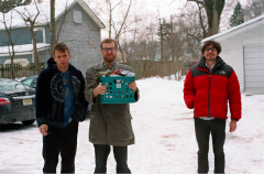 film photograph portrait three young men laundry snow winter hipsters