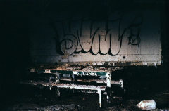 film photograph urbex abandoned building ruinporn graffiti shadow dark chiaroscuro table debris