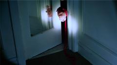 film photograph chiaroscuro light portrait darkness hands door frame tied red rope shibari bondage
