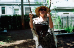 film photograph portrait young woman bokeh dreamy playground swing sunglasses