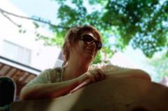 film photograph portrait young woman bokeh dreamy upshot sunglasses smile