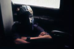 surrealist bokeh film photograph basement dark shadowy portrait boy young man mask creepy