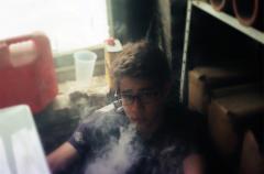 bokeh film photograph portrait young man smoke vape cloud