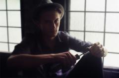 film bokeh photograph portrait young man fedora tool screwdriver pensive