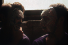surrealist bokeh film photograph basement dark shadowy portrait two boys young men mask creepy looking at each other