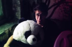 bokeh film photograph portrait young man stuffed panda cute