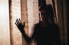 film photograph portrait shadow chiaroscuro blur bokeh silhouette young man curtain