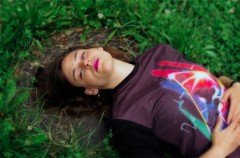 film photograph portrait young woman aerial lying grass outside lipstick fashion
