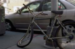 film photography bicycle wheel bent melting surreal dali city