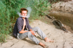 film photography portrait beach summer young man vaping vape clouds