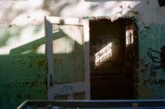 film photography urbex abandoned ruinporn crumbling debris king's park asylum shadow silhouette chiaroscuro peeling paint