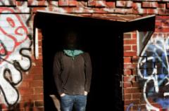 film photography portrait chiaroscuro shadows young man graffiti face hidden