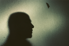 film photography silhouette portrait window bokeh chiaroscuro