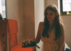 film photograph portrait young woman long hair blonde bokeh neko no ongaeshi pochi pencil case cat black