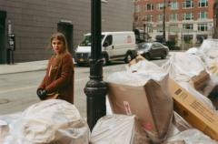 film photograph portrait young woman long hair blonde bokeh trash new york street bags