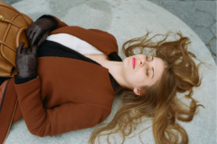 film photograph portrait young woman long hair blonde bokeh lying down leather gloves eyes closed