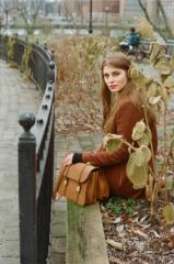 film photograph portrait young woman long hair blonde bokeh sitting park handbag leather