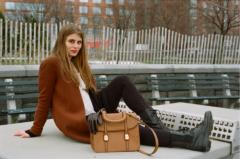 film photograph portrait young woman long hair blonde bokeh park sitting leather gloves handbag purse