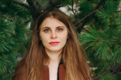 film photograph portrait young woman long hair blonde bokeh pine needles evergreen tree hazel eyes lipstick