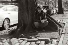 film photograph portrait young man black and white street squatting hapa
