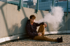 film photograph portrait young man sitting sunshine glasses hapa vape vaping vapelife fat clouds