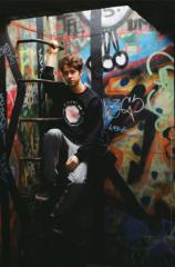film photography urbex abandoned crumbling debris ruinporn portrait graffiti bunker chiaroscuro ladder young man hapa