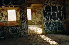 film photography urbex abandoned crumbling debris ruinporn sand graffiti