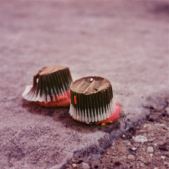 film photograph mini cupcakes chocolate pink frosting icing upside down squashed sad dropped
