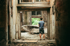 film photography urbex abandoned ruinporn crumbling debris gary indiana union station young man standing doorway chiaroscuro