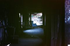 film photography urbex abandoned ruinporn crumbling debris chiaroscuro shadow dark chair screw and bolt factory gary