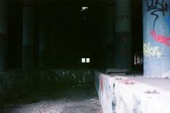 film photography urbex abandoned ruinporn crumbling debris screw and bolt factory gary graffiti columns chiaroscuro shadow