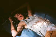 film photograph portrait young man lying down hapa couch double exposure sunlight chiaroscuro